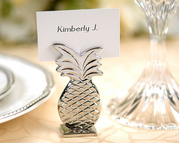 The pineapple is said to be good luck in the home.  A cute place card holder as well as decoration at home!