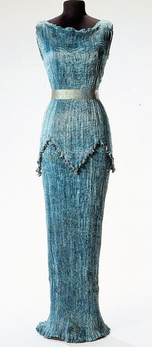 Delphos gown: introduced by Mariano Fortuny, gown influenced by ancient Greek styled dress. Has pleating that could be removed and repleated. Usually dark shades influenced by oriental and Renaissance design.