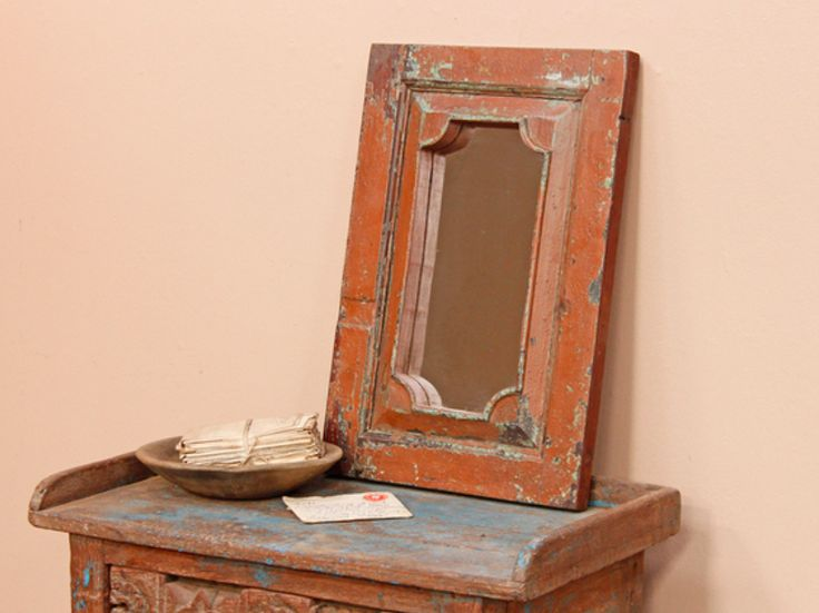A lovely rustic mirror with a stunning paint-distressed brown surface finish which allows a previous layer of paint and vintage teak to poke through. #vintage #mirror #unique #furniture #homedecor #homestyle