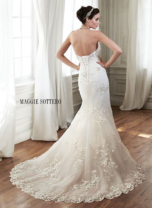 Lace and tulle fit and flare wedding dress, complete with three-dimensional lace appliques, Chante by Maggie Sottero.