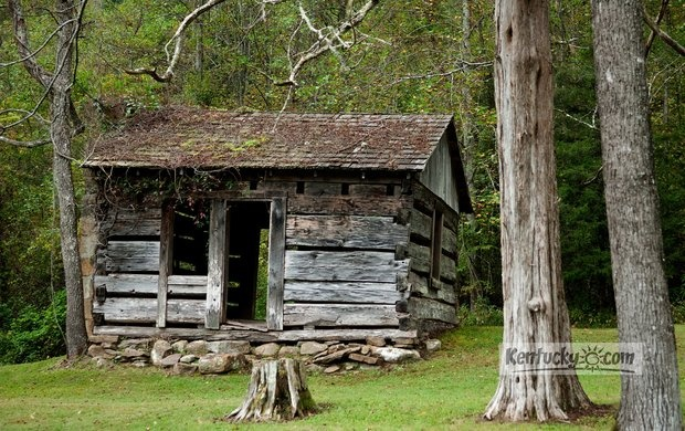 On old cabin built with tulip poplar wood at the turn of the century by the cornett family sits - The recreational vehicle turned cabin in the woods ...