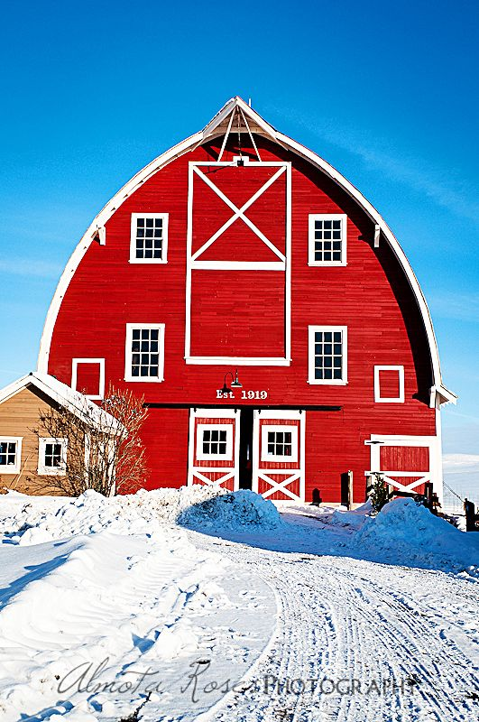 Big red barn in winter.