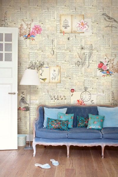 the wallpaper is gorgeous and so are the blues of the sofa