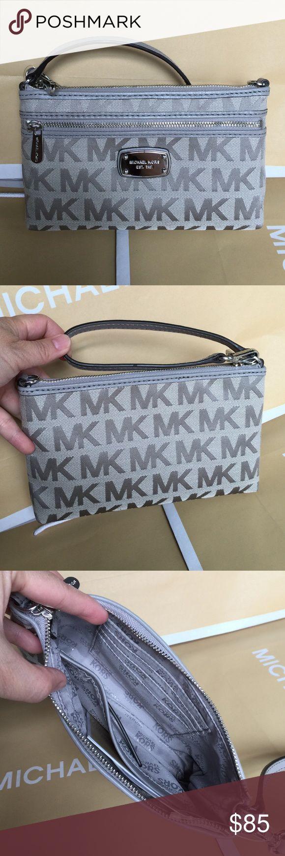 Michael Kors Large Wristlet 100% Authentic Michael Kors Large Size Wristlet, brand new with tag! Michael Kors Bags Clutches & Wristlets
