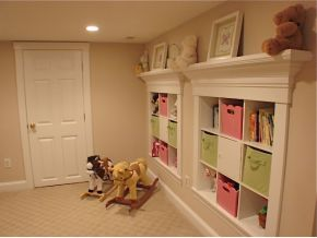 so cute. Built ins for the basement playroom? Love shelf on top?