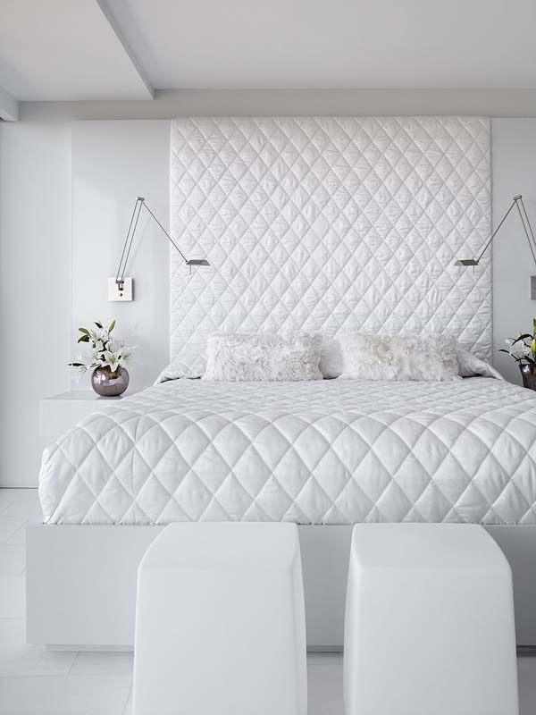 All White Bedroom: not boring design idea.  Simple and so easy: Take the same bed cover and cover a piece of plywood, designing a beautiful, comfortable headboard.