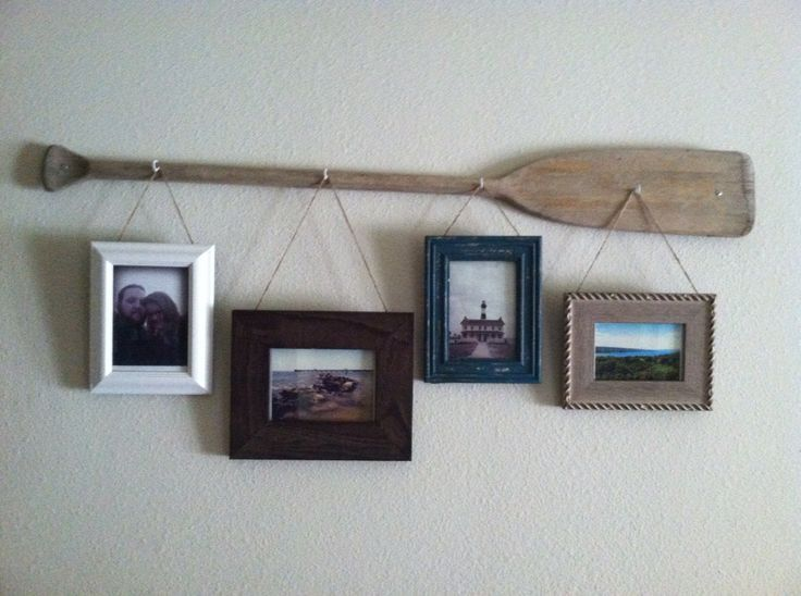 Old Worn Out Wooden Oar With Hooks And Rustic Picture Frames Colors Textures Work Well With Rustic Or Nautical Decor Still Trying To Figure Out If I Want