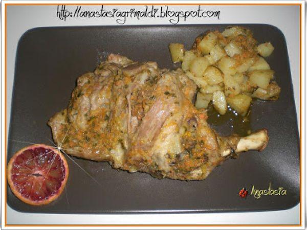 Ricetta Cosciotto di agnello in gremolada all'arancia con patate al forno