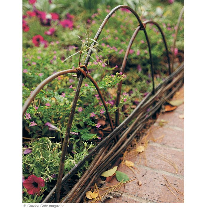 Willow saplings, grapevine, tree suckers and watersprouts are easy to weave into a wattle fence. Thin shoots or brown twine help tie the arches together.