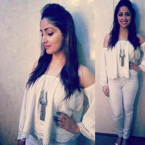 Yami's All White Look is So Sexy... Yami Gautam has been part of controversy, being called out as a home-breaker but that hasn't stopped the lovely actress from looking gorgeous as ever in an all white look in a white croptop and a pendant to match.... Get similar look at https://www.estrolo.com/inspirationapp/yami-gautam/