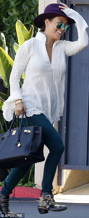 Fashionista: Meanwhile, Kourtney was in dark denim, a pair of studded Chloe boots and a floaty cream blouse