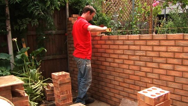how to build a brick wall fence