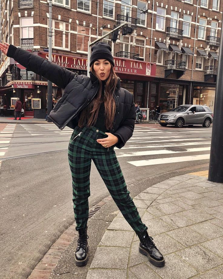 Fall street wear, black bomber and green pattern pants with Dr. Martens. Cute and stylish fashion