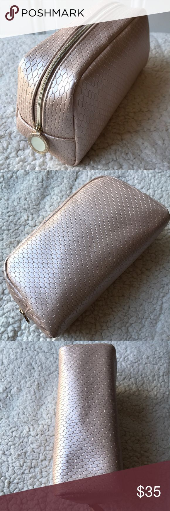 BVLGARI Parfume Pouch Brand new smells beautiful. All original wrapping papers are still inside. Excellent and clean inside out. Tiles patterns. Color is light pink or rose pink. Dimensions is 8L x 4.5H x 3D BVLGARI Bags Cosmetic Bags & Cases
