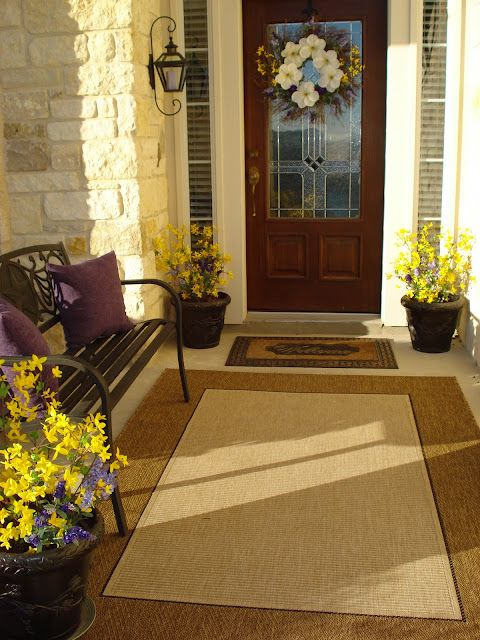 I like the large mat and the smaller mat by the front door. Maybe a small bench to he left of the door