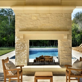 Two way outdoor fireplace