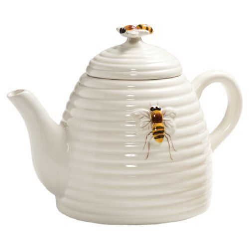Beehive Teapot ... ivory or cream colour, in shape of horizontally ribbed skep (straw beehive), with raised bee on side and bee as knob, earthenware, China
