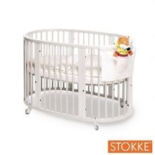 Stokke Sleepi Bed - White Sleepi is four beds in 1, beginning with a bassinet size mini crib which expands to a crib. By lowering the mattress platform it converts into a toddler bed. An optional expansion kit can carry your child to age 10 in a junior bed. Sleepi's Iconic Scandinavian design creates a small footprint in your nursery. Sleepi is constructed of 100% solid cultivated beech wood, a material known for its strength and stability.