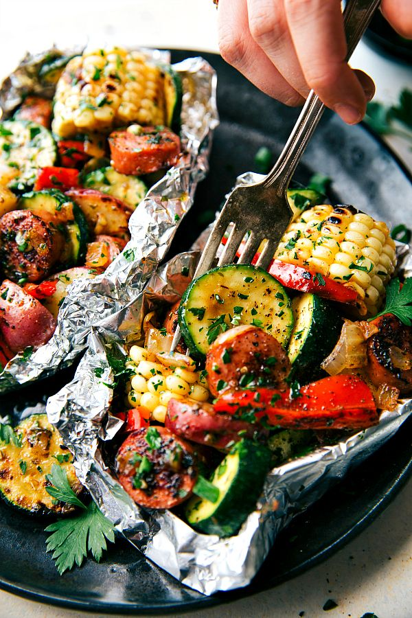Delicious and easy tin foil packets  packed with sausage and tons of veggies