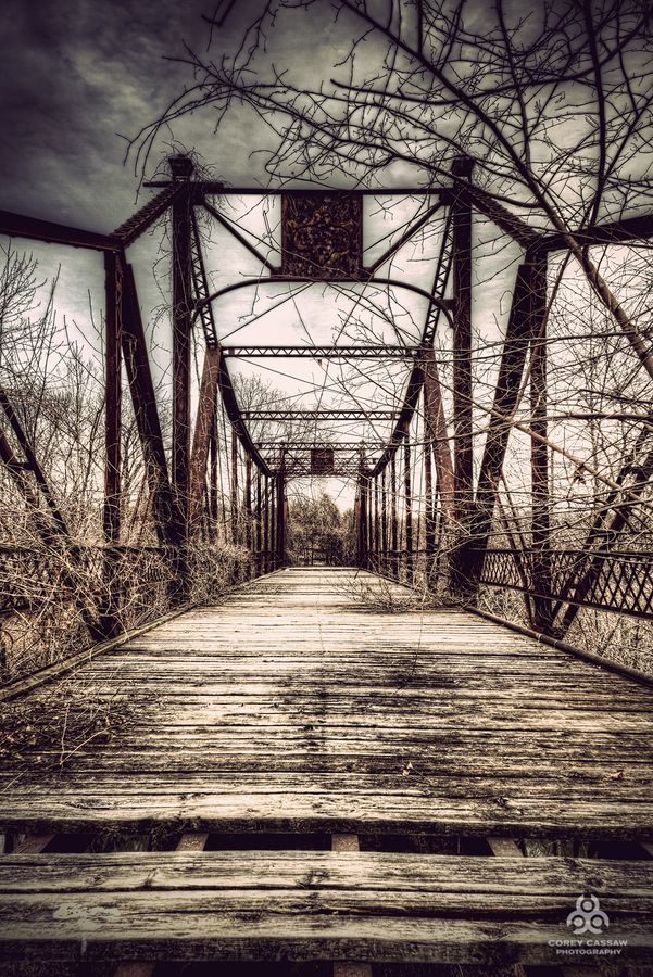 photo by Corey Cassaw. This abandoned bridge connects the city of Osawatomie, KS to the grounds of the Osawatomie State Hospital.