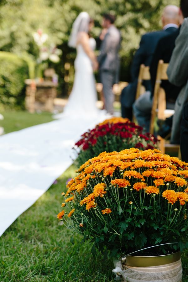 Ceremony Aisle Lined With Colorful Potted Mums| {Intimate & Colorful} Early Fall Wedding|Photographer: Story and Rhythm