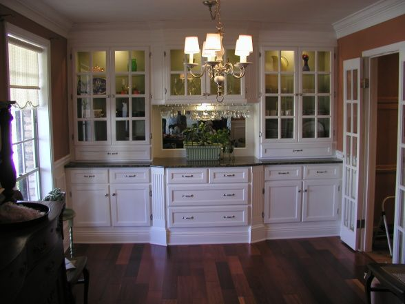 China/Storage Cabinet, Built In China Cabinet With Plenty Of Storage. All  Wood With Granite Top, And Lighted Glass Shelves. The Dining Table.