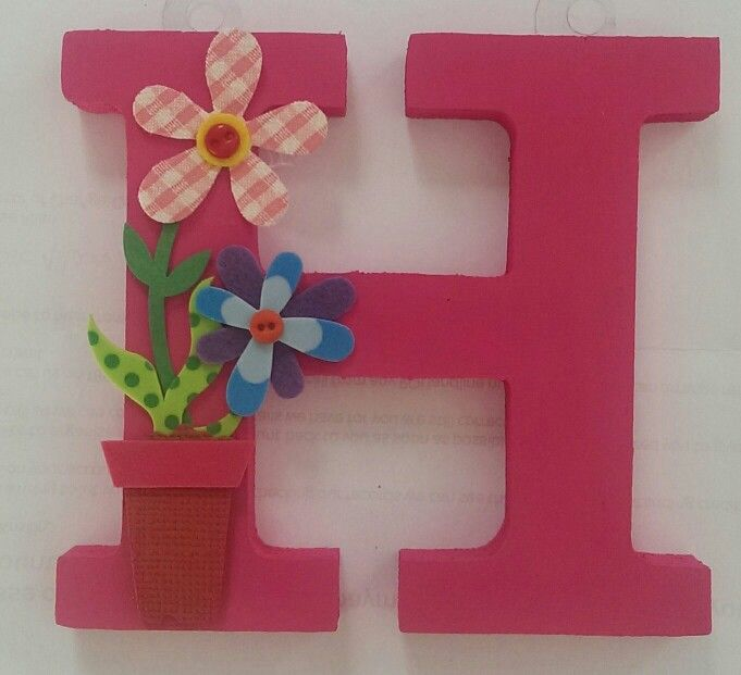 Wooden monogram with flower embellishment