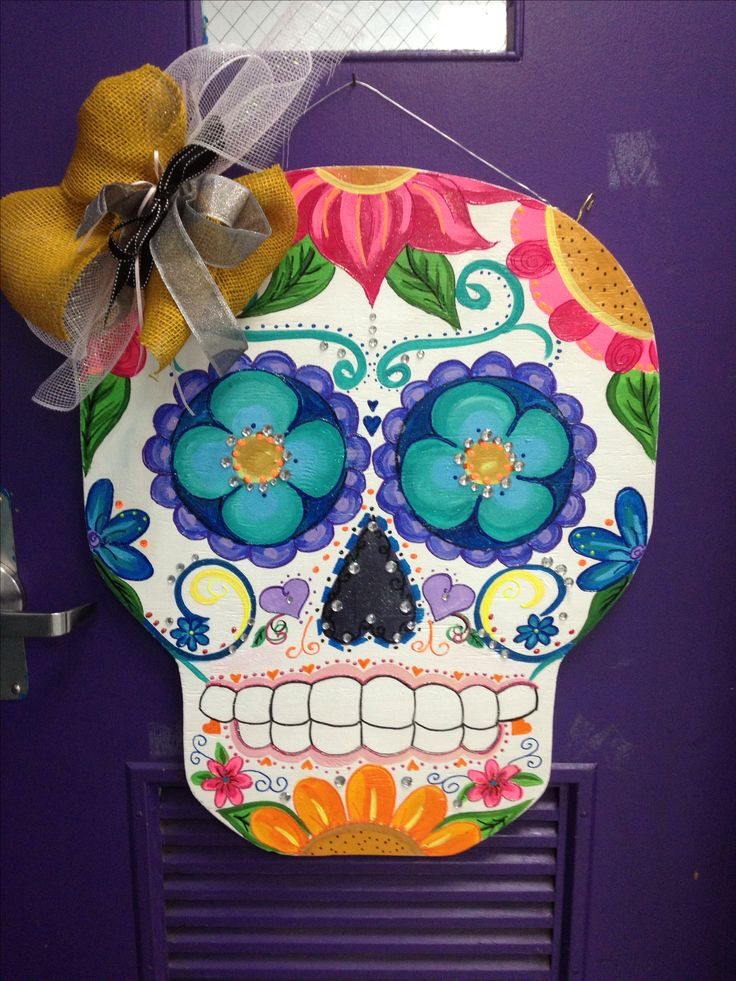 Sugar skull door hanger- I painted this sugar skull for my Day of the  Dead activities....(cut from plywood, decorated with acrylics and ribbon)