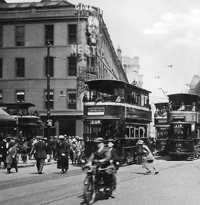 Old photograph of a motorbike and Trams on Argyle Street in Glasgow , Scotland . Originally known as Westergait, Argyle Street led west from...
