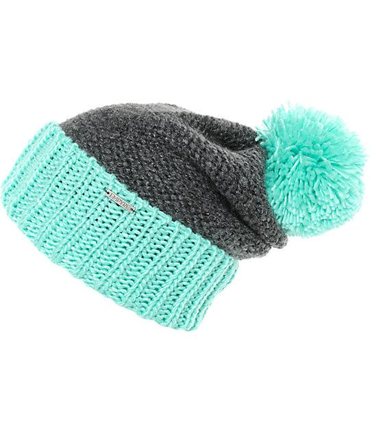 Top off your cold weather look with the styling of this slouchy cuffed beanie that is made with a chunky knit construction and a large size pom at the top.