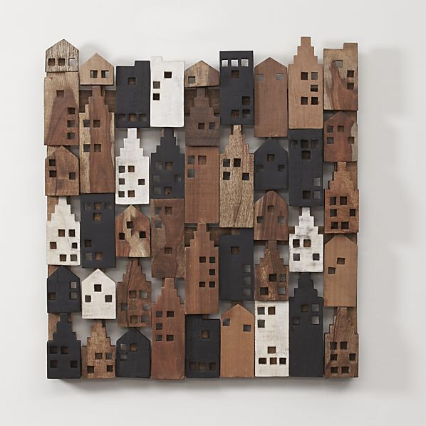 This charming wall art piece brings out the best of urban living in a composite village of mango, shesham and sal wood houses. Dotting the composition of brown and white houses are black ones incorporating the methods of the Japanese art of shou sugi ban, a home siding technique that preserves wood by charring, cleaning and finishing it with oil.