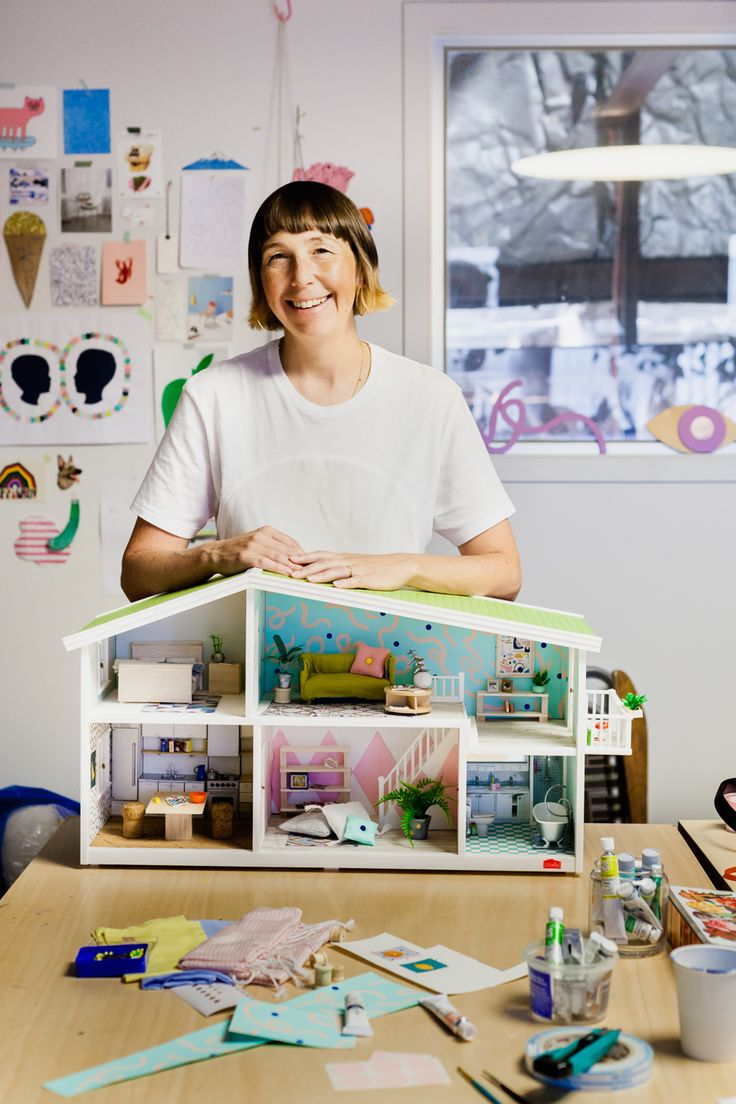 Beci Orpin with her Petite Collaborations Lundby Dollhouse creation. Photography by Amelia Stanwix for The Petite Edit.