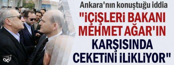 """""""İçişleri Bakanı Mehmet Ağar'ın karşısında ceketini ilikliyor"""""""