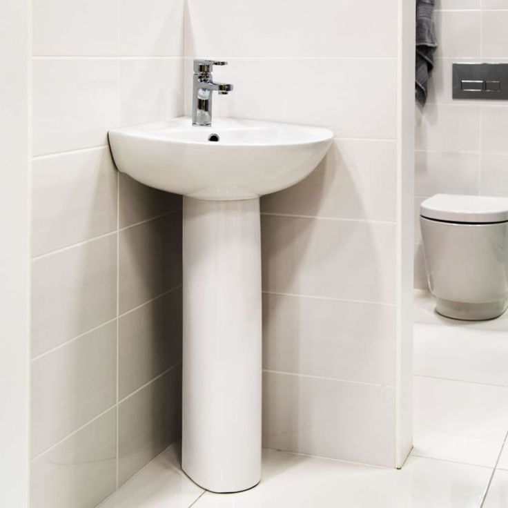 Make the most of your bathroom space by installing this Stefano Corner Pedestal Basin. This pedestal basin has been expertly crafted from a durable white ceramic, ensuring hassle-free cleaning, perfect for busy family bathrooms. The clever design means yo