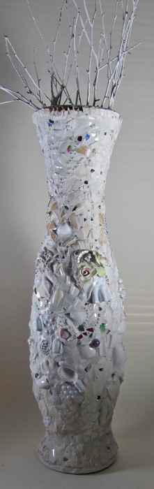 By Mosaic Artist: Melissa Miller  Huge White Vase of shards, pearls, mirror pieces, jewels, flowers, beads, and other found treasures.