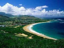 Nevis, West Indies...home of a Four Seasons Resort and sugar cane plantations with monkeys in the rain forest....no airport, arrive via boat from St. Kitts.