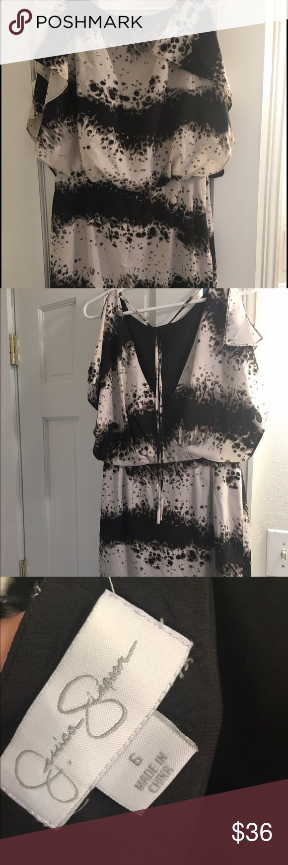 Jessica Simpson Dress Almost new Jessica Simpson size 6 dress with a tie at the top of the back, split sleeves, deep v back and unique cream and black print. Flowy sleeves and sinched at the waist. Hits above the knees. Perfect with classic black pumps for work or stilettos for a wedding or semi formal affair. Jessica Simpson Dresses