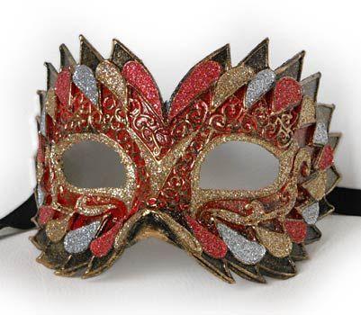Flash rosso V26 - Maschera originale veneziana realizzata interamente a mano, in cartapesta e decorata con colori acrili e glitter.