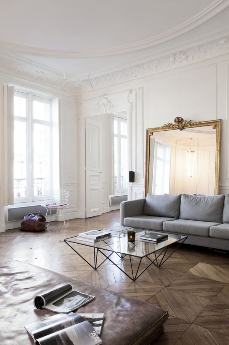 A gorgeous, spacious Paris apartment with stunning wall moulding