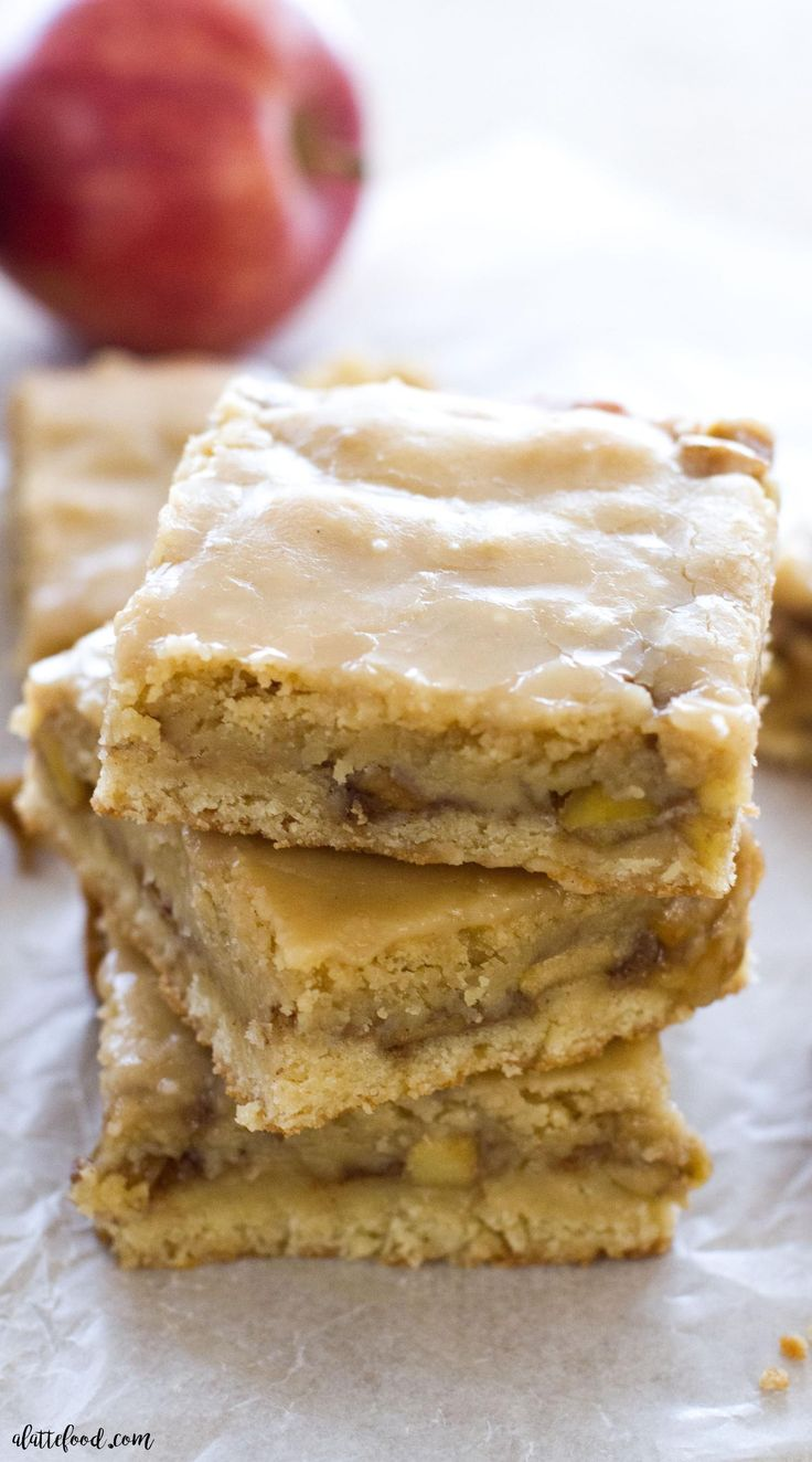 These chewy Maple Glazed Apple Blondies taste like sweet apple pie with a warm maple icing! This homemade apple blondie recipe is the perfect fall dessert! It's easy, super flavorful, and always a crowd pleaser!