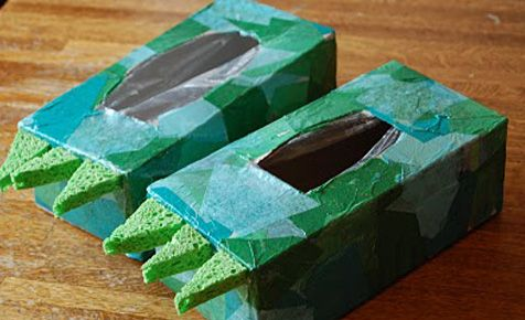 Funosaurus idea #2: Dinosaur feet  This easy craft will transform your child into their favourite dinosaur in no time. These dino-shoes can be made from two leftover tissue boxes, and your child can paint them in whatever colour they like. You can even make scary dino-claws out of clean sponges! Then the kids can slip on their amazing new dino-shoes and get stuck into some serious dinosaur stomping. Click the link below for instructions from blogger A bird and a bean.