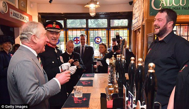 Well-deserved pint: Charles enjoys a drink in the Prince of Wales pub during their visit to Congleton town centre, his final engagement of the day before returning to London