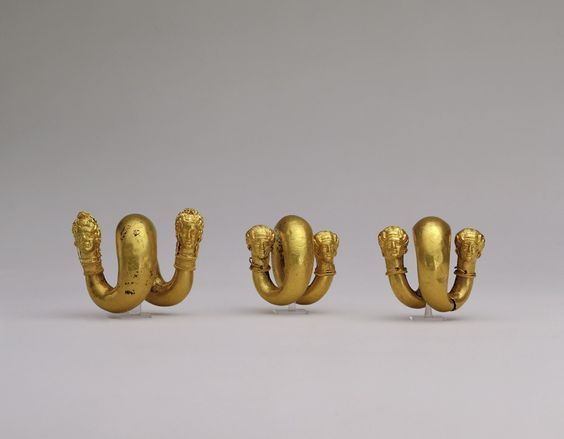 Greek gold spirals with female protomes, classical period, third quarter of the 4th century B.C. Allegedly from Selinunte,  Tarentine. Scholars are unanimous in ascribing such spiral ornaments surmounted by female protomes to Tarentum, though there is controversy as to whether they are to be considered as hair-rings or ear-ring, 2cm to 4 cm long. George Ortiz collection