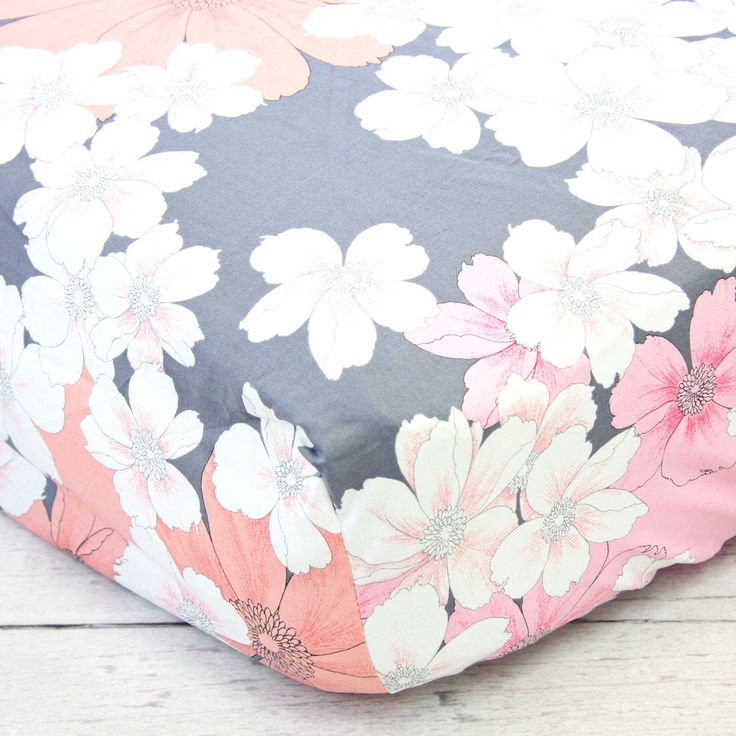 This pink and gray floral crib sheet has just a touch of coral in it also. Love the coral and pink together.