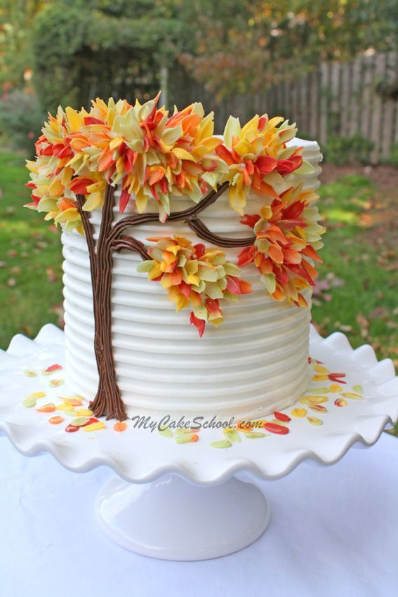 Autumn Leaves in Chocolate - from My Cake School - candy melt leaves on buttercream.  Looks surprisingly easy for such a dramatic result! #themedcakes