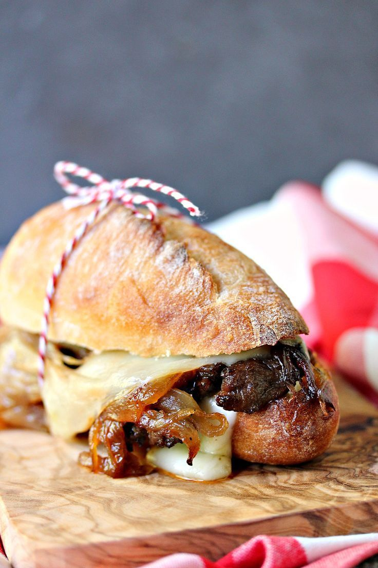Steak Sandwiches with Caramelized Onions and Provolone Cheese from http://cravingsofalunatic.com- This easy recipe will be a hit with everyone who tries it. Grilled steak, caramelized onions, provolone cheese, all stacked perfectly on a French baguette. Take a bite! (/CravingsLunatic/) #sponsored /sargentocheese/