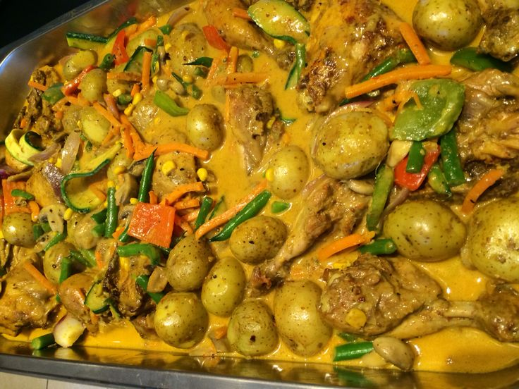 Chicken coconut curry in a array of vegetables