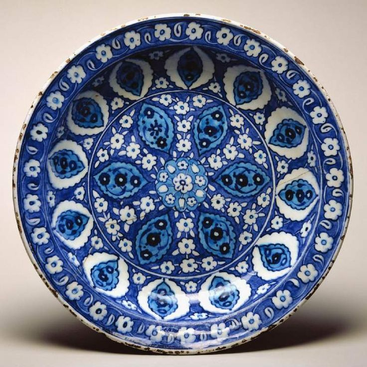 Maker:    Unknown; potter    Category:    fritware (stonepaste)    Name(s):    dish  Islamic pottery; category  Iznik; category    Date:    cica 1535 — circa 1545    School/Style:    Ottoman    Period:    early to mid 16th century