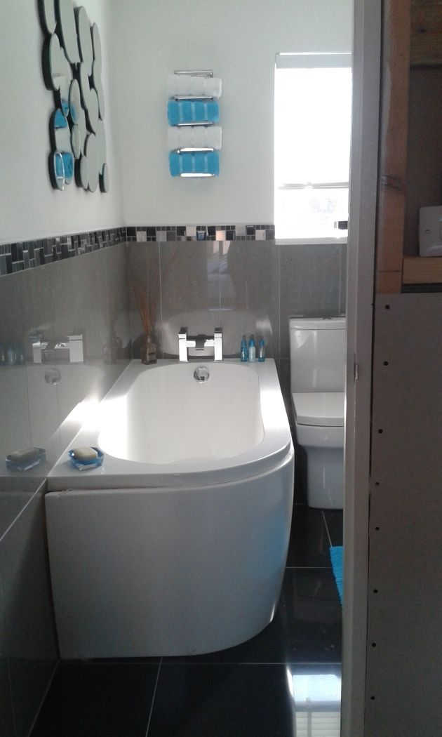 The fantastic modern corner bath looks brilliant alongside the brown wall tiles and white wall in this bathroom by Steve from Plymouth #VPShareYourStyle