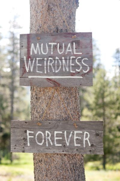 Ceremony Ideas: 9 Couples Who Know That Weddings Are Just An Excuse To Have A Good Time - mutual weirdness forever sign